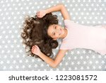 girl child with long hair lay... | Shutterstock . vector #1223081572