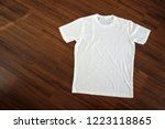 white t shirt on wood background | Shutterstock . vector #1223118865