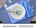 unclean  dirty bowl and spoon... | Shutterstock . vector #1223131312
