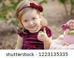 little girl and decorated party ... | Shutterstock . vector #1223135335