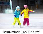 children skating on indoor ice... | Shutterstock . vector #1223146795