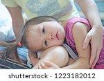 little sad girl on mothers...   Shutterstock . vector #1223182012