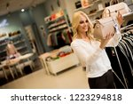 pretty young woman buying purse ... | Shutterstock . vector #1223294818