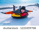 man snow tubing from hill....   Shutterstock . vector #1223359708