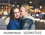 happy couple  man kissing his... | Shutterstock . vector #1223417122