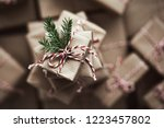 small gift box on top of a pile ... | Shutterstock . vector #1223457802