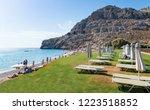 umbrellas and sunbeds on green...   Shutterstock . vector #1223518852
