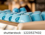 blue glass coffee cups staying... | Shutterstock . vector #1223527432