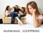 teenage girl looks in the phone ...   Shutterstock . vector #1223598262