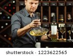 sommelier holding decanter in... | Shutterstock . vector #1223622565