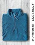 blue sport folded pullover on... | Shutterstock . vector #1223658325