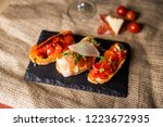 bruschetta with ham parmesan... | Shutterstock . vector #1223672935