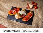 bruschetta with ham parmesan... | Shutterstock . vector #1223672938