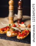 bruschetta with ham parmesan... | Shutterstock . vector #1223691475