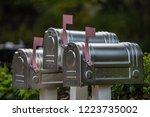 three silver metallic mailboxes ... | Shutterstock . vector #1223735002