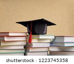 graduation hat and stacks of... | Shutterstock . vector #1223745358