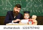 teacher and pupil in...   Shutterstock . vector #1223757442