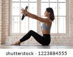 sporty woman doing pilates... | Shutterstock . vector #1223884555