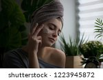 young woman applying face cream ... | Shutterstock . vector #1223945872