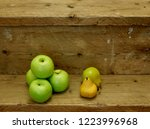 apples and pears on wooden...   Shutterstock . vector #1223996968