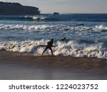 dynamic spirited surfers keenly ... | Shutterstock . vector #1224023752