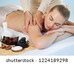 masseur doing massage on woman... | Shutterstock . vector #1224189298