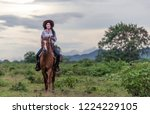cowgirl  riding on a mountain... | Shutterstock . vector #1224229105