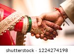 Indian Hindu Couple Holding...