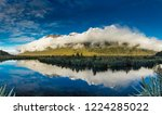 Mirror Lakes with reflection of Earl Mountains, Fjordland National Park, Millford Road, New Zealand