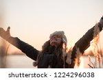 young happy woman enjoying the... | Shutterstock . vector #1224296038