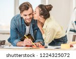 young woman kissing smiling man ... | Shutterstock . vector #1224325072