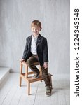cute young boy  sitting on a...   Shutterstock . vector #1224343348