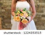 bride holding her bouquet | Shutterstock . vector #1224353515
