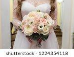 bride holding her bouquet | Shutterstock . vector #1224354118