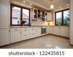 Stock photo horizontal view of the beige kitchen 122435815