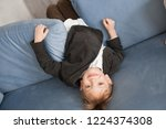 overjoyed boy play on couch at...   Shutterstock . vector #1224374308