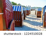 hooded beach chairs at the... | Shutterstock . vector #1224510028