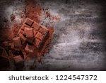 broken chocolate pieces and... | Shutterstock . vector #1224547372