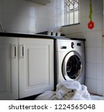 laundry in front of washing...   Shutterstock . vector #1224565048