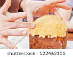 Christmas cake decorated by hands closeup - stock photo