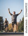 the two sportsmen running on... | Shutterstock . vector #1224660922