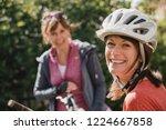 headshot of a mature female... | Shutterstock . vector #1224667858