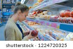woman buying sausage at grocery ... | Shutterstock . vector #1224720325