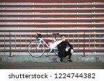 Cyclist Sitting By A Bike ...