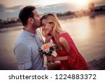 happy young couple having fun... | Shutterstock . vector #1224883372