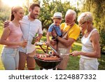 family having a barbecue lunch... | Shutterstock . vector #1224887332