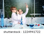 two children scientists making... | Shutterstock . vector #1224941722