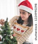 happy asian woman wearing red... | Shutterstock . vector #1224990298