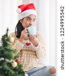 asian woman wearing santa hat... | Shutterstock . vector #1224995542