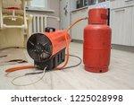 repairmen install stretch... | Shutterstock . vector #1225028998